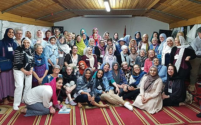Members of the Sisterhood of Salaam Shalom in the annex of the Dar Assalam Mosque in Berlin, which hosted the group for dinner, prayers, and interfaith dialogue. Photo courtesy Heba Macksoud