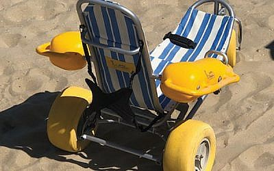Wheelchairs that can be taken into the water are available upon request (and with lifeguard supervision) at North Bath Avenue Beach in Long Branch. Photo by Martin J. Raffel
