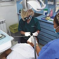 Dr. Michele Schultz working with a patient at the Trudi Birger Dental Clinic in Jerusalem. Photos courtesy Michele Schultz