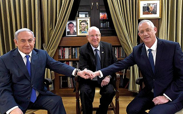 Israeli President Reuven Rivlin, center, at the beginning of his meeting this week with Likud's Benjamin Netanyahu, left, and Blue and White leader Benny Gantz. Haim Zach (GPO)