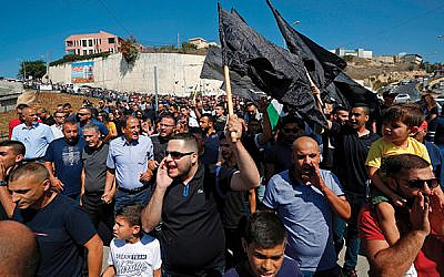 Israeli Arabs protest last Friday in the northern Israeli town of Umm-Al Fahem, calling on police to do more to stop a wave of violence in their communities.  Getty Images