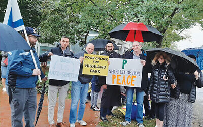 """About 120 people protested the reading of """"P is for Palestine"""" at the Highland Park Library. Photos by Debra Rubin"""