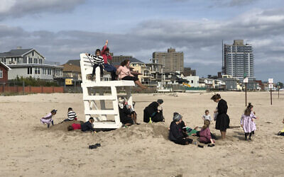 "A photo from Judy Maurer's exhibition, ""Hasidim On The Beach"" on display at The Bishop Gallery in Bed-Stuy until Nov., 2. Courtesy of Judy Maurer/The Bishop Gallery"