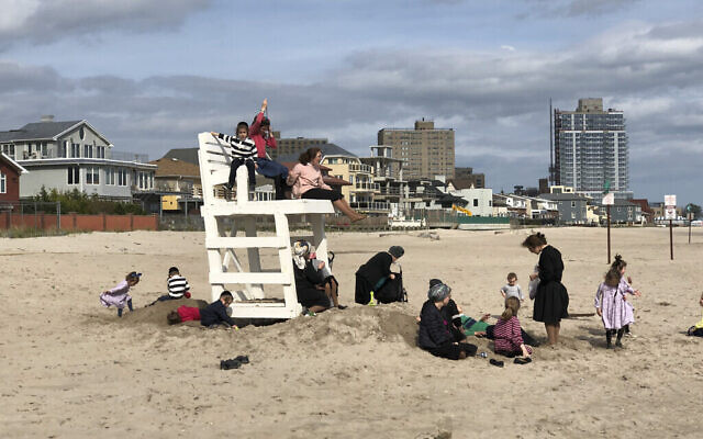 """A photo from Judy Maurer's exhibition, """"Hasidim On The Beach"""" on display at The Bishop Gallery in Bed-Stuy until Nov., 2. Courtesy of Judy Maurer/The Bishop Gallery"""