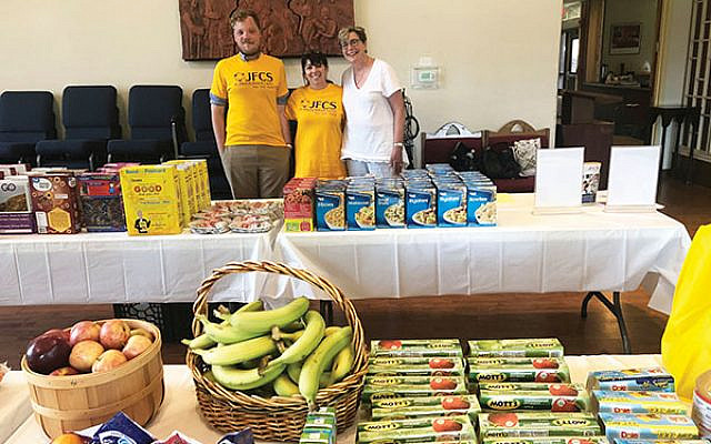 On July 10 at a JFCS pop-up pantry at Christ Congregation in Princeton are JFCS staff members, from left, Will Harrison, Beth Englezos, and Helaine Isaacs. This pantry, the first at the church, served over 60 individuals, a second one about 80; it will now be scheduled monthly. Photo by Michelle Napell