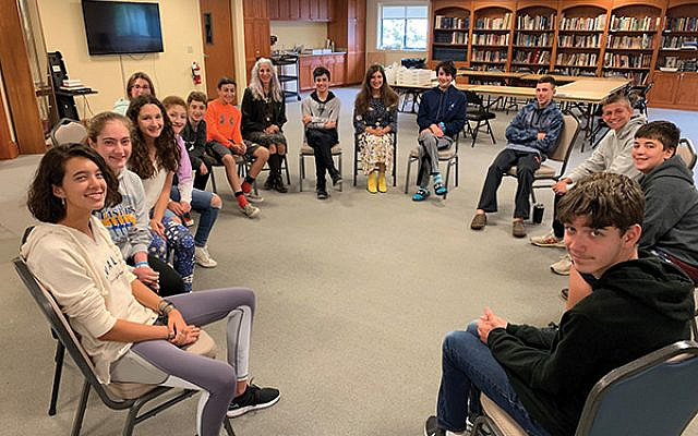 A year after the Pittsburgh Tree of Life attack, teens, like these at Temple Shalom in Succasunna, have various views about the rise in anti-Semitism. Photo by Johanna Ginsberg