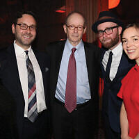 Gary Rosenblatt, center, at the Nov. 13 gala marking his retirement as editor and publisher of the New York Jewish Week, NJJN's sister publication. With him are his wife, Judy Rosenblatt, and his three children, from left, Avi and Dov Rosenblatt, and Tali Rosenblatt Cohen. Photo by Nomi Ellenson