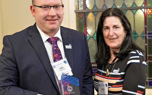 Eric Wallenstein of Highland Park received the Seymour St. Lifer Award from federation executive director Susan Antman for his leadership in the Life & Legacy program.  Photo courtesy Jewish Federation in the Heart of NJ
