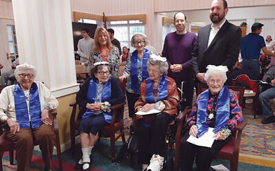 Five residents at Martin and Edith Stein Assisted Living in Somerset celebrated their b'not mitzvah, including Esther Samuels, seated at left, Sophie Melman, Ida Rose, and Sali Frank. Standing, from left, are Jackie Kott, Renee Waller, Cory Heimberg, and Rabbi Bryan Kinzbrunner. Photo by Debra Rubin
