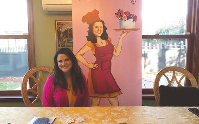 Nathalie Glazier displays some of her Kosherfest-winning cookie-cutter line at her Newtown, Pa., home.
