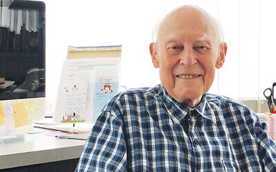 Robert Max in his home office in Summit. Photo by Jed Weisberger