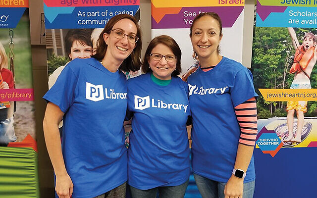 Three PJ Library Ambassadors in the Jewish Federation in the Heart of NJ are, from left, Shira Madnick, Anne Goodman, and Joanna Koster.  Photo courtesy of the Jewish Federation in the Heart of NJ