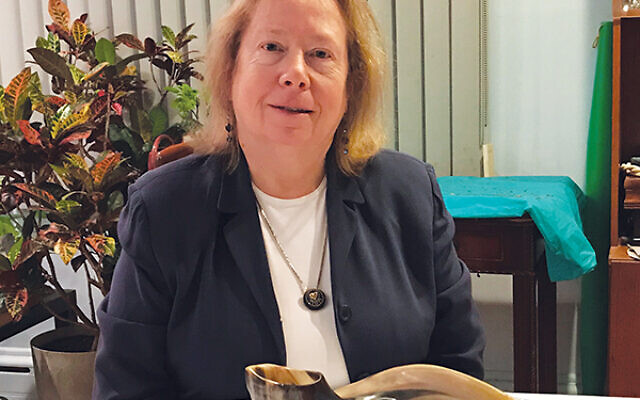 Rabbi Stephanie Dickstein with some of the religious objects she brings when counseling Holocaust survivors.