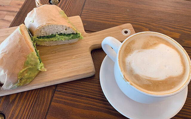 A guacamole and greens sandwich with a latte at Bakeristor, which opened Dec. 5 in Linden. Photos by Johanna Ginsberg