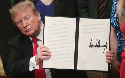 President Trump at last week's signing ceremony for an executive order extending protections for Jewish college students under Title VI of the Civil Rights Act. The order touched off a heated debate in the Jewish community. Getty Images
