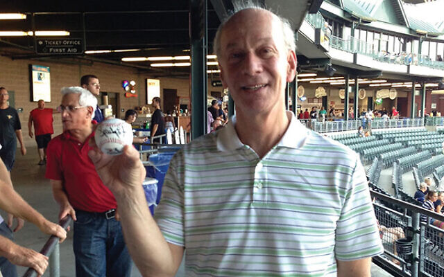 Mark Rattner shows off a ball autographed by Sparky Lyle, former Major League player and Somerset Patriots manager, at JNF's Jewish Heritage Day at TD Bank Ballpark in Bridgewater.