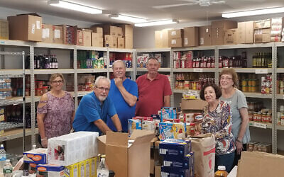 Volunteers take inventory at the Jewish Family Service of Central NJ food pantry in Elizabeth. Photo Courtesy JFS of Central NJ