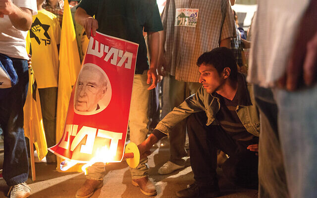 """A scene from """"Incitement,"""" Yaron Zilberman's new film about religious nationalist Yigal Amir and his 1995 assassination of Israeli Prime Minister Yitzhak Rabin. Courtesy Greenwich Entertainment"""