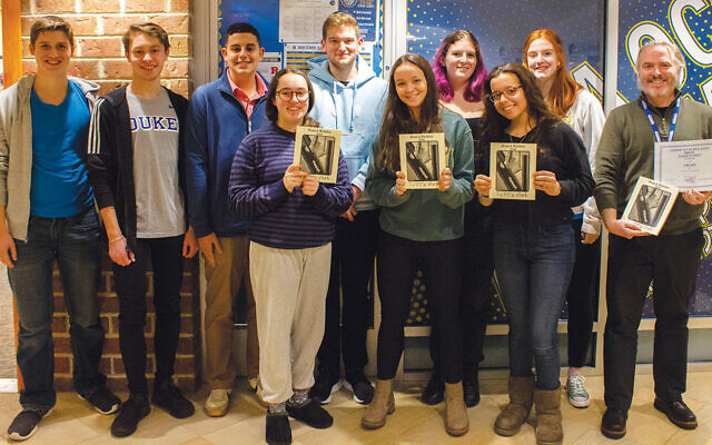 """Members of the editorial board of Golda Och Academy's """"Nuts and Raisins"""" literary magazine with faculty adviser Jason Langer, far right."""
