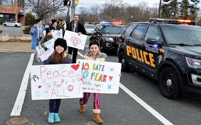 A march against anti-Semitism in Livingston, organized by Brandon Minde (center, second row) on social media. Photo by Jerry Siskind