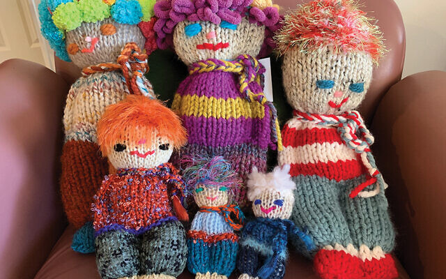 Sue Brown estimates that she's knitted more than a 100 comfort dolls for children.  Photos by Johanna Ginsberg