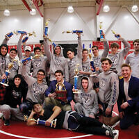 The Kushner Cobras wrestling team won their third straight championship at a national day school competition.