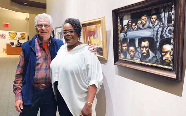 "TSTI Art Committee president Richard Koch with curator Armisey Smith in front of ""Slave Ship"" by Akil Roper. Photos by Johanna Ginsberg"