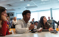 Pleasantville High School senior Ernest Howard prepares to ask Ed Mosberg, through an interactive hologram, about food in the concentration camp of Mauthausen. Photos courtesy of Stockton University