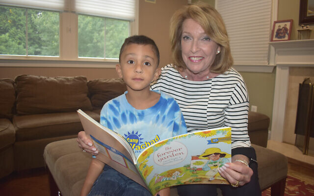 Maxine Murnick with Nate Melville, son of Lisa and Philip Melville of Scotch Plains, who was the 300,000th recipient of a Greater MetroWest PJ Library book in 2017.
