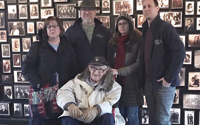 """Standing behind Cantor David Wisnia in Auschwitz-Birkenau's """"sauna"""" building are his son Rabbi Eric Wisnia and family, wife Judith and children Sara and Avi. As a prisoner, David worked in the delousing facility; today it is an exhibit hall at the Auschwitz Museum. Photos Courtesy Avi Wisnia"""