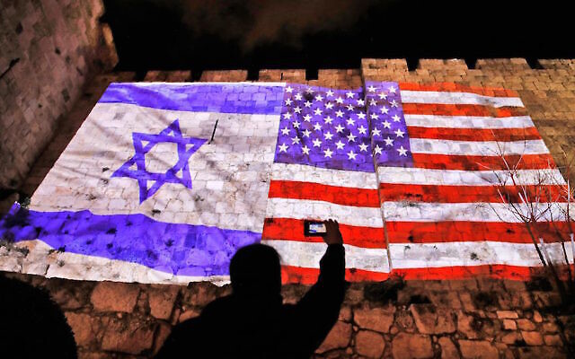 Illustrative: The U.S. and Israel flags on the walls of the Old City in Jerusalem, Dec. 6, 2017. Getty Images