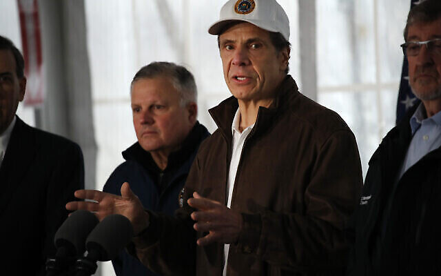 New York Governor Andrew Cuomo speaks to the media and tours a newly opened drive through COVID-19 mobile testing center on March 13, 2020 in New Rochelle, New York. Spencer Platt/Getty Images
