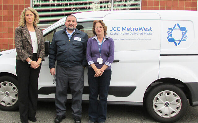 Standing in front of an Essex County Meals on Wheels delivery van are, from left, Joanne Bramnick, director of Center for Adult Enrichment at JCC MetroWest; Charles Penasiel, driver at Daughters of Israel Metro Transport; and Cindy Denburg, director of Metro Transport. Photo Courtesy Daughters of Israel