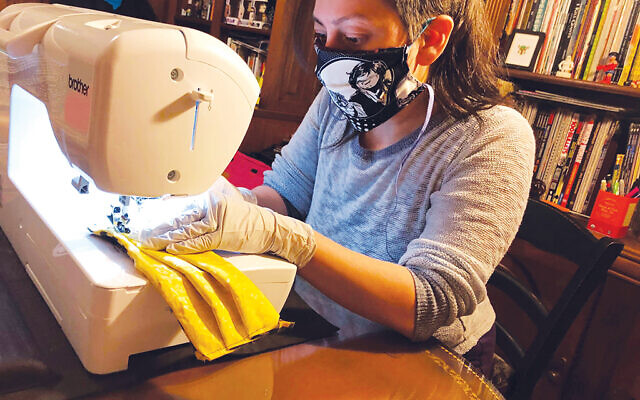 Alba Hochman sewing much-needed face masks for health-care workers.  Photo by Naomi Hochman