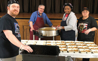Despite the pandemic, staff members at the YM-YWHA of Union County, including, from left, Dennis Scalia, Phil Slepian, Dee Smith, and Valerie McCombs, are continuing to prepare more than 200 meals each day for the county's Meals on Wheels program. Photo courtesy Joanne Glassoff