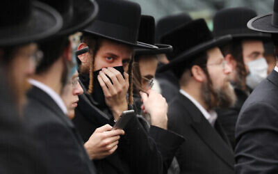 Hundreds of Orthodox Jews gather in Borough Park on Sunday at the funeral of a rabbi who died from coronavirus. The outbreak is hitting charedi neighborhoods especially hard. Getty Images