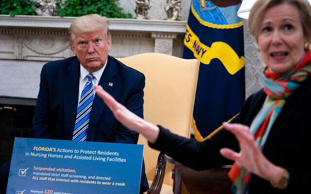 White House Coronavirus Task Force Coordinator Deborah Birx (R) answers a question while meeting with Florida Gov. Ron DeSantis and U.S. President Donald Trump in the Oval Office of the White House on April 28, 2020 in Washington, DC. Doug Mills/The New York Times/Pool/Getty Images