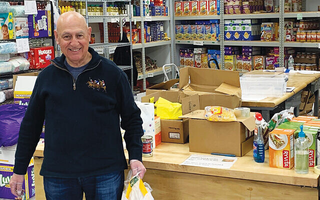 Marty Axelrod, a volunteer for Jewish Family Service of Central New Jersey, is ready to deliver groceries from the food pantry in Elizabeth. Photos courtesy Jewish Family Service of Central New Jersey