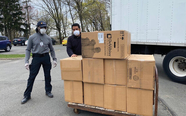 Boxes with oxygen concentrators are delivered to Regency Nursing Centers.
