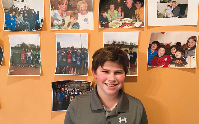 Jake Green held his bar mitzvah service at home with 150 guests in attendance on Zoom. Photos of family members decorated the walls of the Greens' home in Newtown, Pa. Photo Courtesy Green family