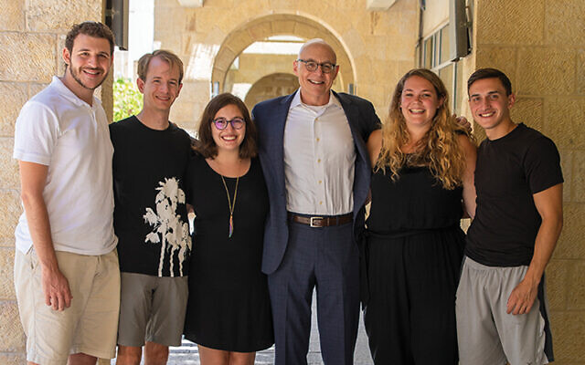 """Andrew Rehfeld, with students at HUC's campus in Israel, is bracing for a year of distance learning or """"an on-again, off-again year if the quarantine comes back."""" Photo courtesy Huc.edu"""