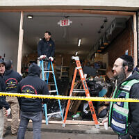 Demolition and recovery crews work at the scene of the Dec. 10, 2019, shooting at a kosher grocery store in Jersey City where three civilians were murdered. RYAN R. SMITH/Afp/AFP via Getty Images