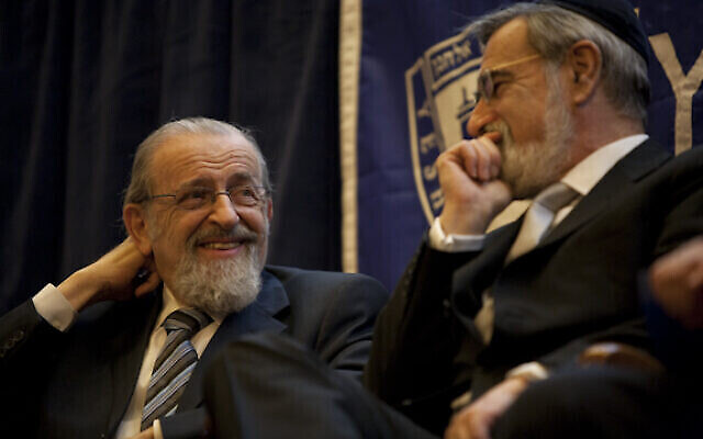 Lord Jonathan Sacks, Chief Rabbi of the United Kingdom, right, receives the inaugural Norman Lamm Prize, established in celebration the 80th birthday of Lamm, left, the chancellor of Yeshiva University, March 18, 2010. (Yeshiva University)
