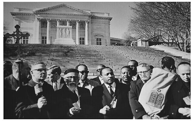 Rabbi Abraham Joshua Heschel, front row, second from left, joins Dr. Martin Luther King Jr. in prayer at the Tomb of the Unknown Soldier at Arlington Cemetery, Feb. 6, 1968. The action was sponsored by Clergy and Laity Concerned About Vietnam. (Photo by Ray Lustig, courtesy of the D.C. Public Library Washington Star Collection)