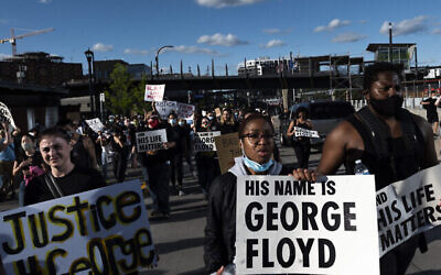 Protesters in Minneapolis demonstrate against the death in police custody of George Floyd, May 29, 2020. (Stephen Maturen/Getty Images via JTA)