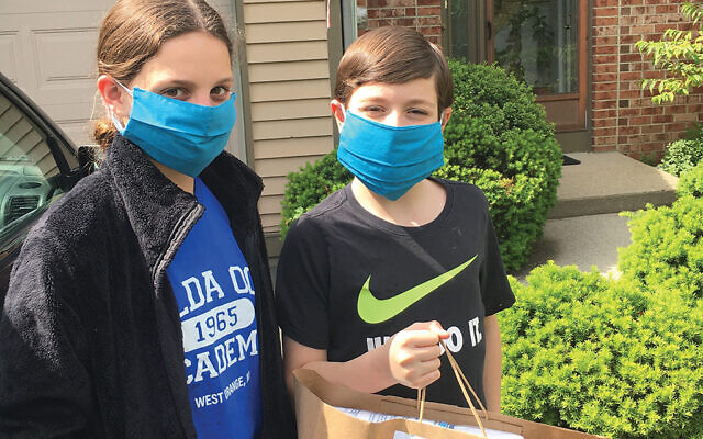 Arielle and Ethan Karni volunteered to deliver packages to survivors, along with their mother, Samantha.
