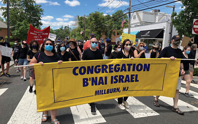 Incoming Rabbi Ari Isenberg, center, and members of Congregation B'nai Israel march in a June 7 demonstration in Millburn. Photo by Shira Vickar-Fox