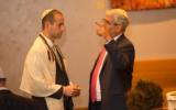 Billy Grenis, at left, with Rabbi Adam Feldman in 2017.