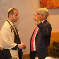 Billy Grenis, at left, with Rabbi Adam Feldman in 2017.