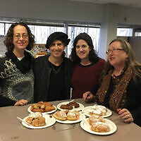 NJJN staffers taste test varieties of sufganiyot, jelly donuts, and Moroccan treats for Chanukah.